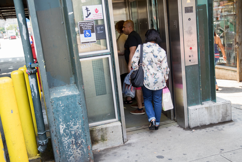 Commuters board the elevator on the downtown side of the 1 train at West 231st Street, the only 1 train station in the Bronx that is ADA-compliant.