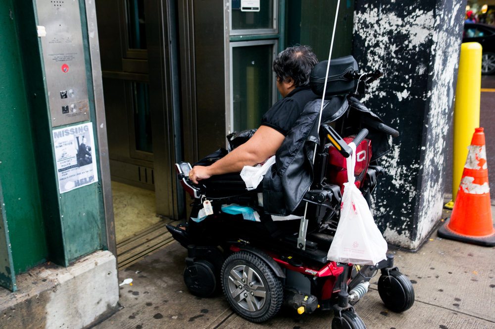 Iffat Mahmud-Khan boards the elevator at the West 231st Street 1 train station in 2017. Mahmud-Khan is an avid user of the city's transit system, but finds she can't use every subway station because many of them are not accessible to people with disabilities.