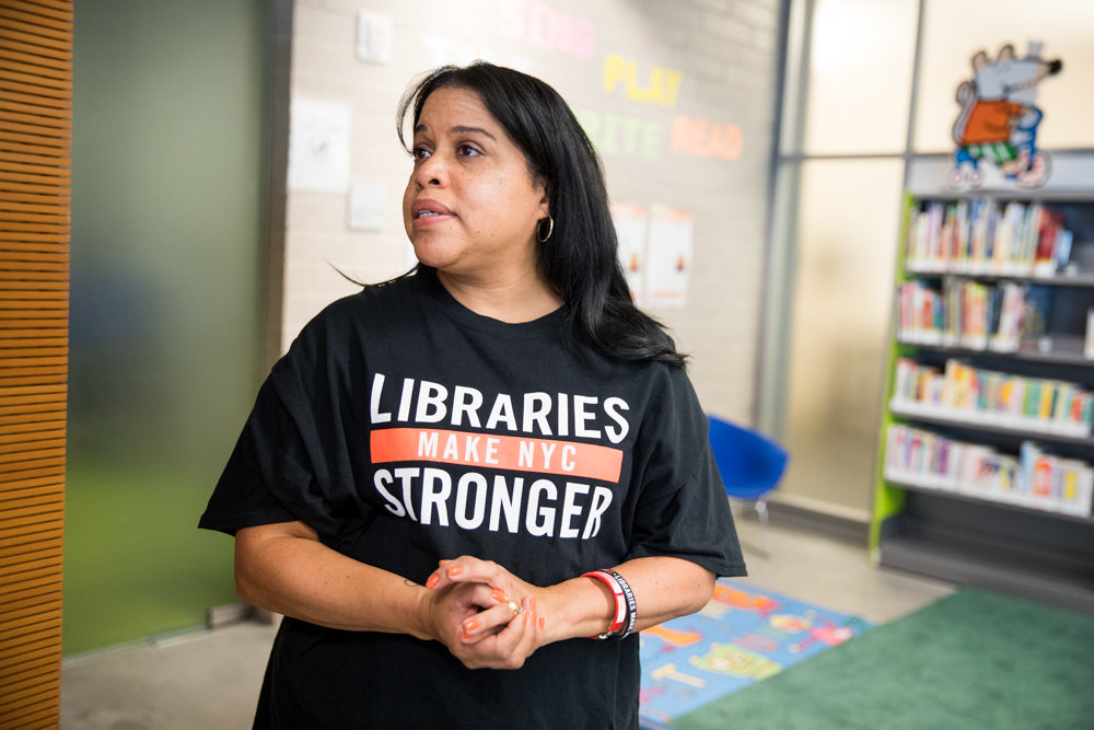 Martha Gonzalez-Buitrago, manager of the Kingsbridge library, is wary of what the proposed $10.4 million cut to library funding in next year's city budget might mean.