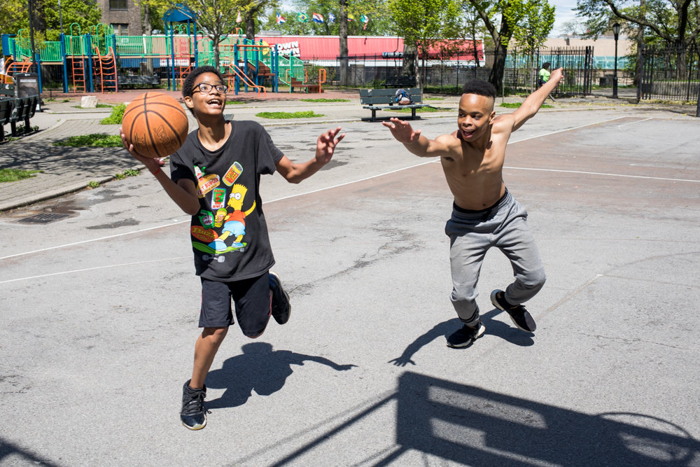 Eric Garcia, left, and Isaiah Pagan play 'king of the court' at Fort Four Park.