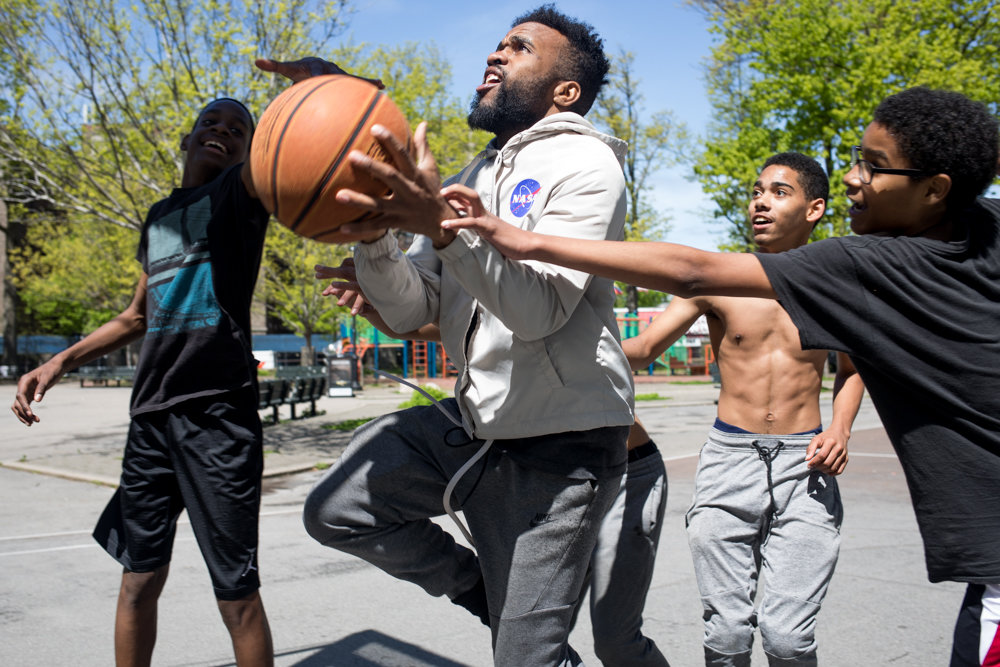 Joel Guerrero, center, demonstrates his basketball skills in a game of 'king of the court' at Fort Four Park. A Kingsbridge Heights resident of 20 years, Guerrero has raised more than $8,000 toward the revitalization of the basketball courts at Fort Four Park.