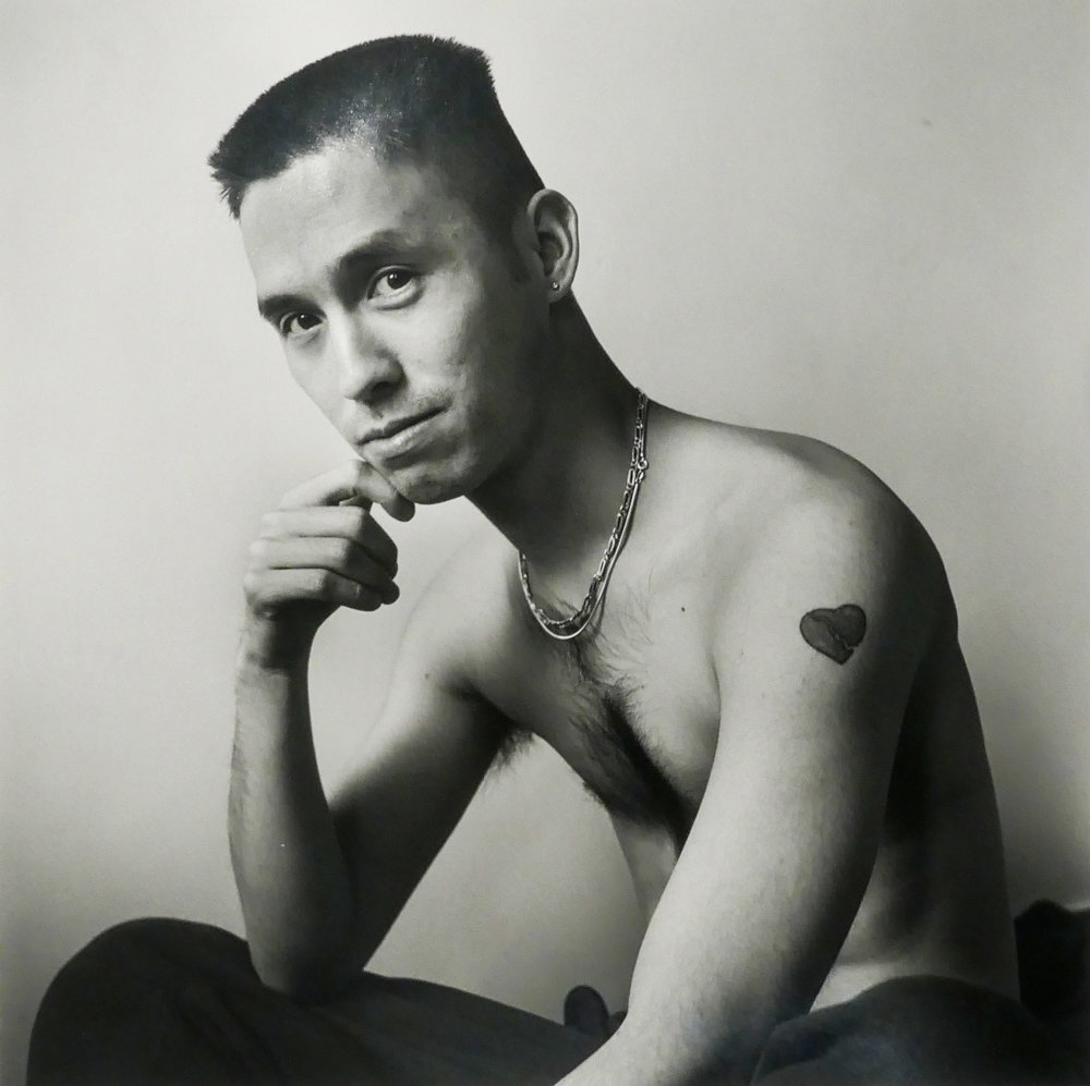 Writer Norman Wong sits for a portrait by Robert Giard in New York City in 1992.