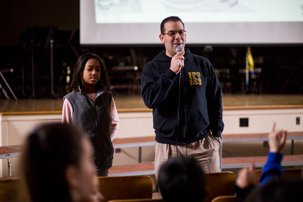 P.S. 24 principal Steven Schwartz gives opening remarks at a presentation about African American history in February. A group of parents wrote a letter in support of Schwartz and his administration by denouncing anonymous emails alleging the principal has ignored his duties.
