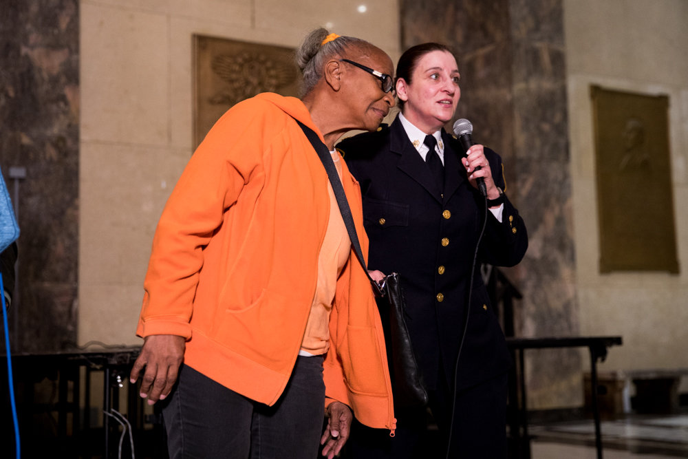 Deputy inspector Jessica Corey demonstrates how not to wear a purse with Marian McCormick during a press conference about the Bronx's efforts to combat elder abuse.