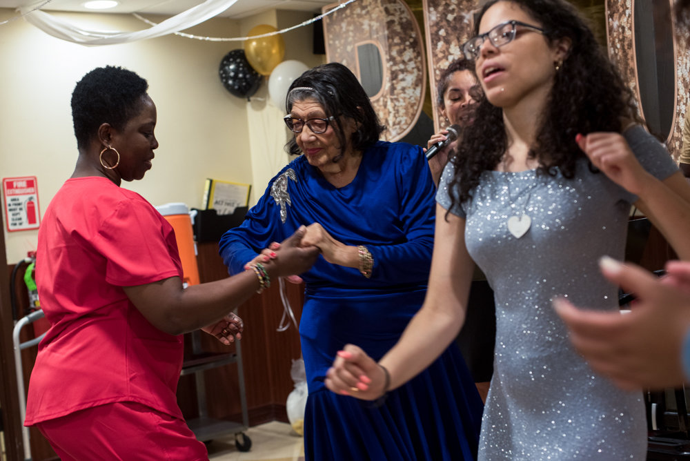 Park Gardens Rehab & Nursing Center resident Benedicta Torres, center, dances with staff members and Marble High School students for the facility's second annual Senior/Senior Prom.