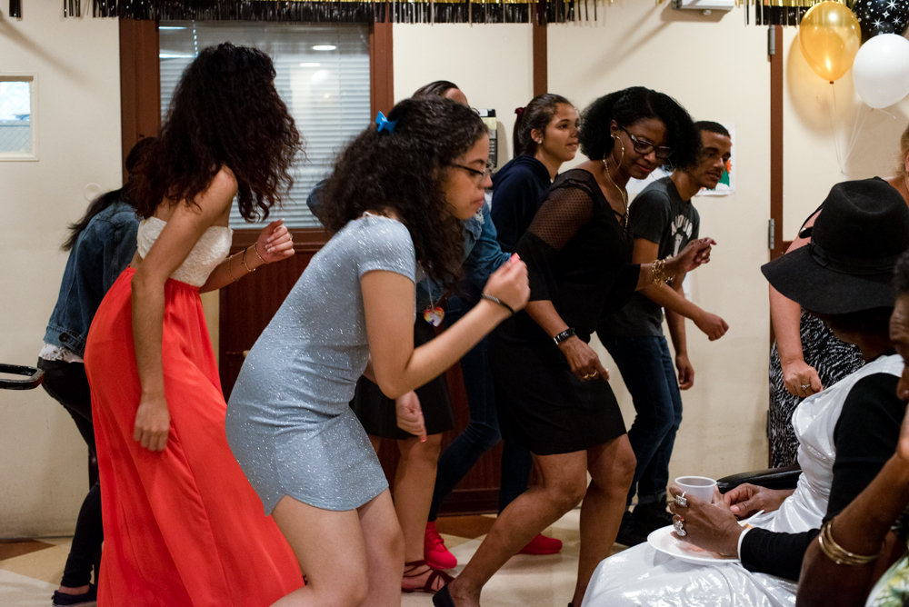 Marble Hill High School students and Park Gardens Rehab & Nursing Center staff members sing and dance to entertain the facility's residents at the Senior/Senior Prom.