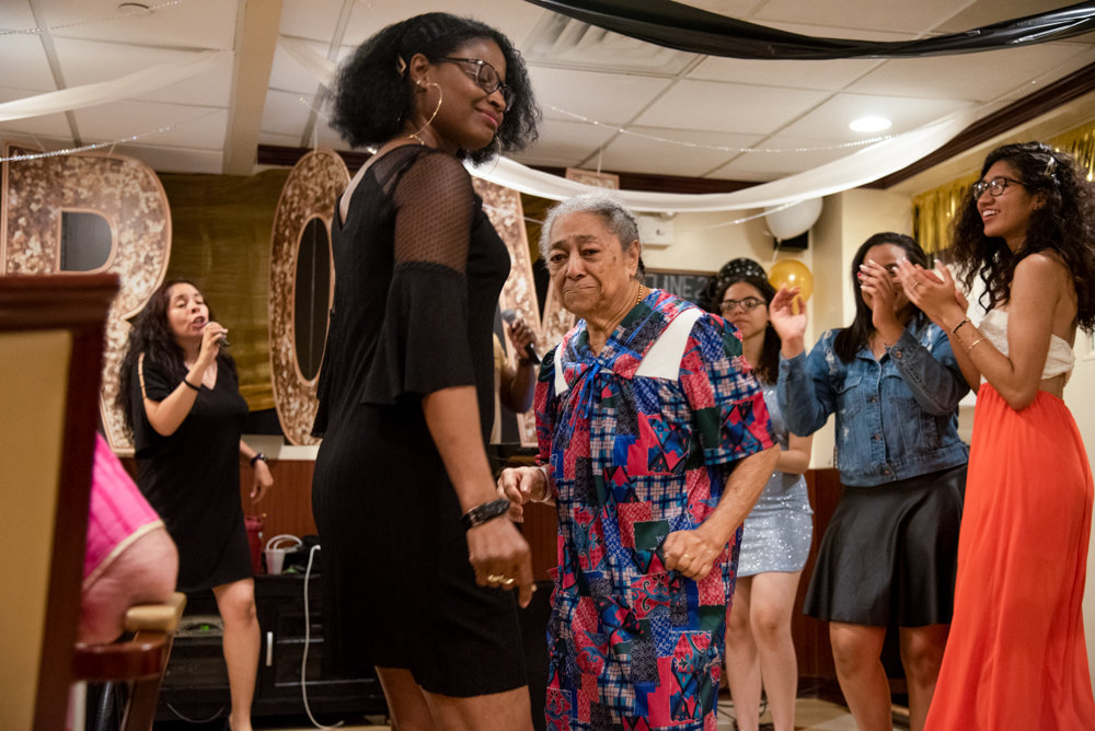 Juana Felix, center, a resident of Park Gardens Rehab & Nursing Center dances with staff members and Marble Hill High School students for the center's second annual Senior/Senior Prom.