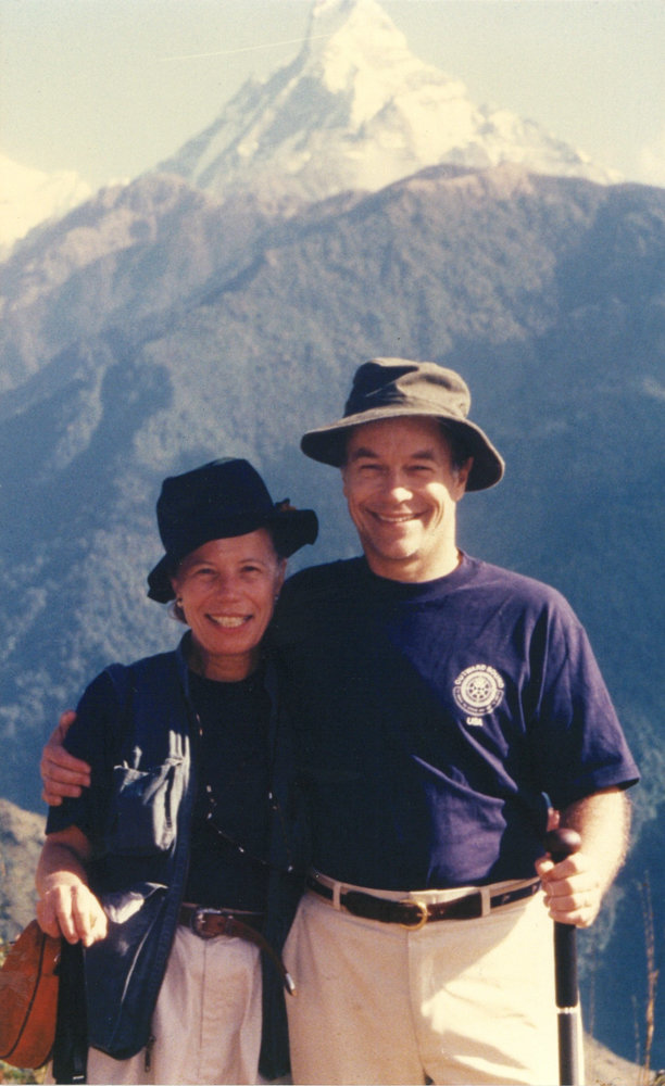 David Beim smiles with his wife Elizabeth in Bhutan in 2000. Beim died June 6 at t 79.