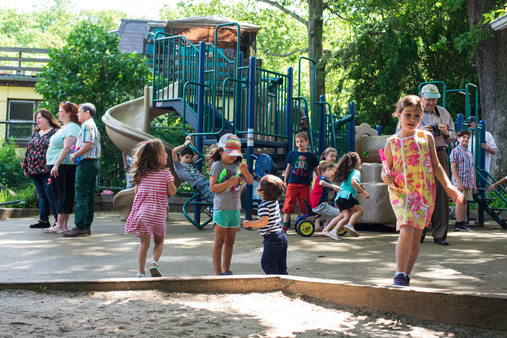 Children play in the Gartner Pachman Family Playground, a newly dedicated playground at the Riverdale Presbyterian Church Nursery School. The dedication honors the memory of Charlie Pachman, the infant son of Jodi and Jason Pachman, who died suddenly last year.