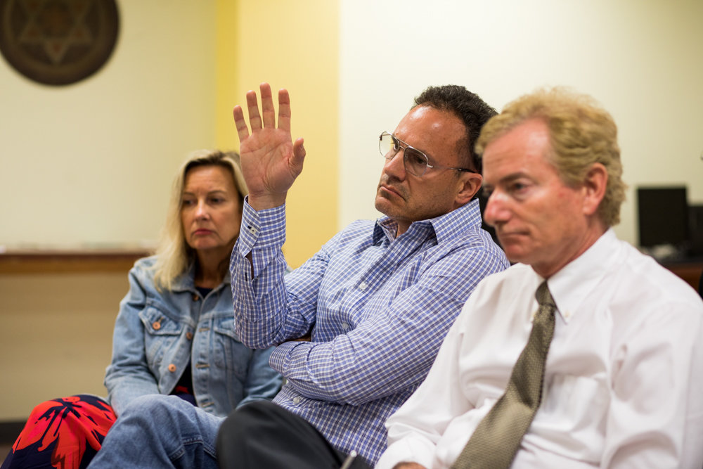 Cliff Stanton, chair of the Friends of the Hudson River Greenway, raises his hand to ask Bob Bender a question during a meeting of Community Board 8's special greenway committee June 12.