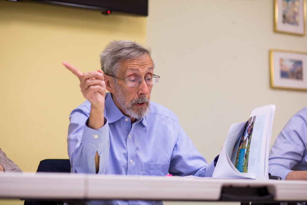 Bob Bender reads from the minutes of an MTA board meeting during Community Board 8's special greenway committee's first meeting of 2019. Bender believes the MTA is required to take measures to combat the effects of climate change that would align with the goals of the greenway project.