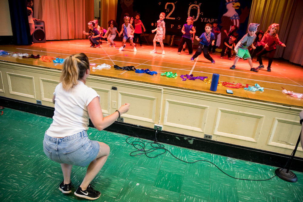 P.S. 81 kindergarten director Jessica Kirby leads students through a dance number during a dress rehearsal for 'P.S. 81 Looks Back,' a 20-year retrospective of the school's theatrical productions.