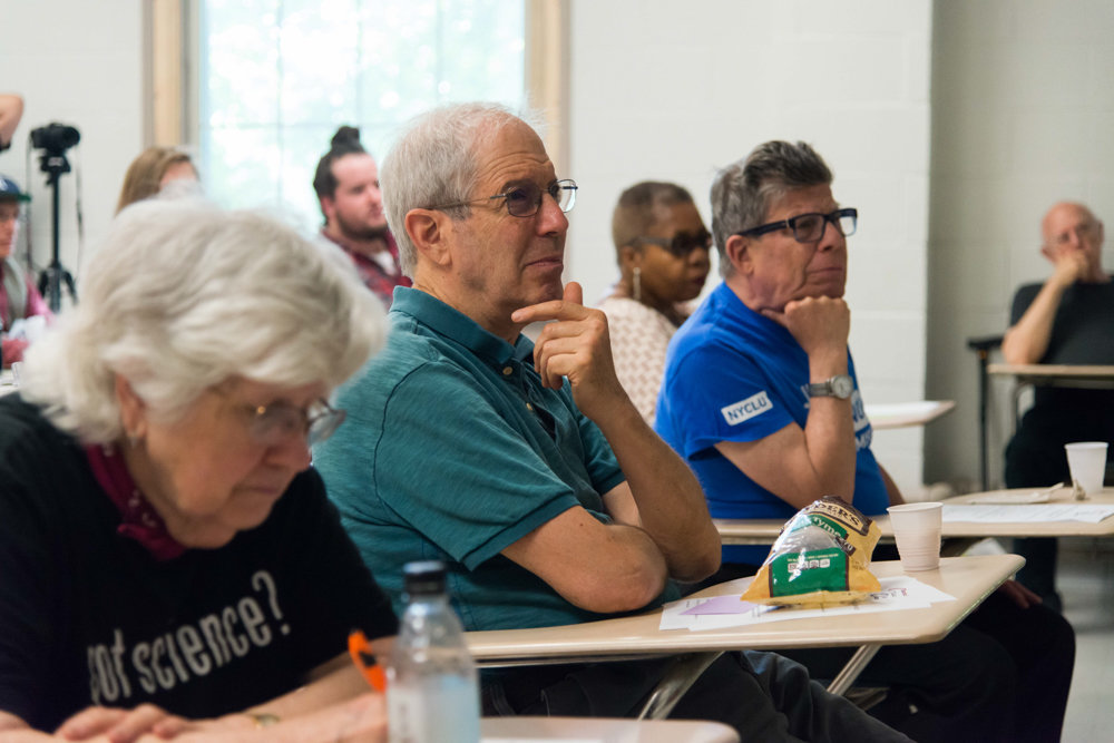 Attendees listen to Assemblyman Jeffrey Dinowitz provide updates on the progressive agenda in Albany during a forum hosted by Concerned Citizens for Change at Manhattan College.