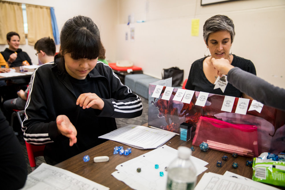 Hannah Chen rolls a die during an after-school Dungeons and Dragons campaign held at the Spuyten Duyvil Library.