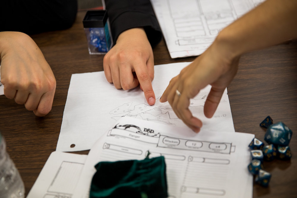 Players indicate where they want to progress in a Dungeons and Dragons campaign during an after-school session at the Spuyten Duyvil Library.
