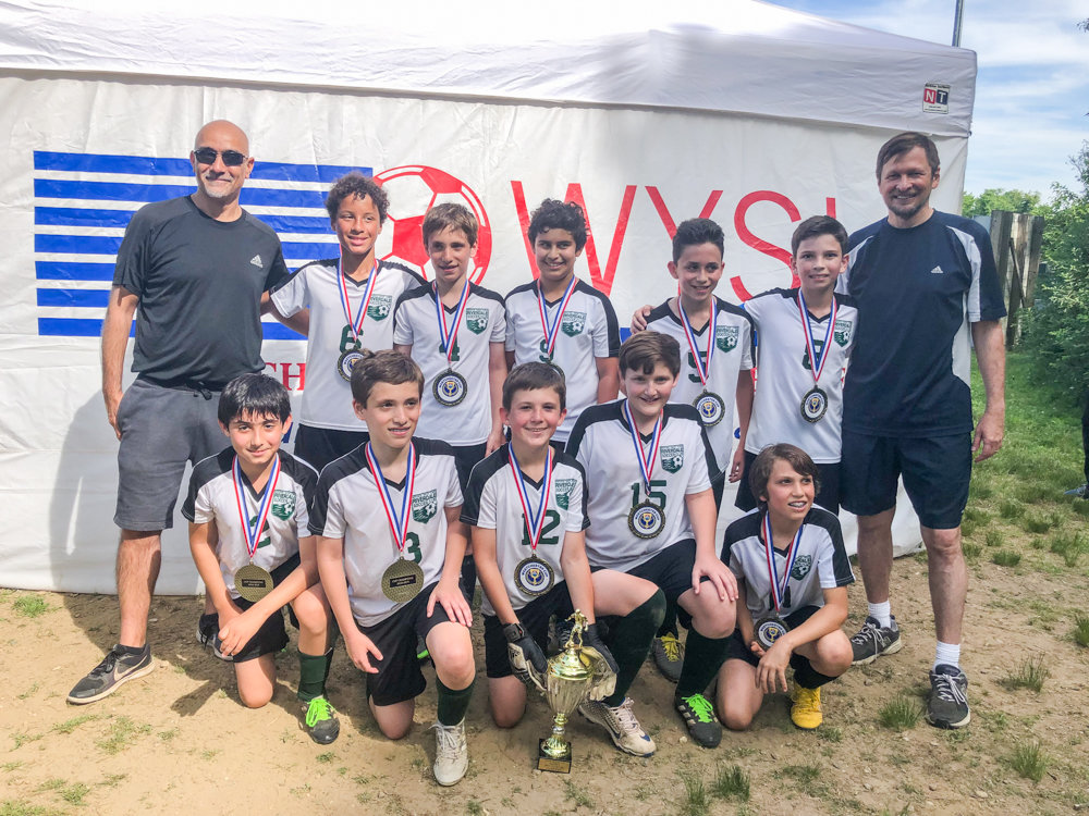 Co-coaches Yaron Babila, back left, and Leo Liberman, back right, flank their Riverdale Hornets team fresh off a victory that earned them the U12 boys Silver Westchester Cup.