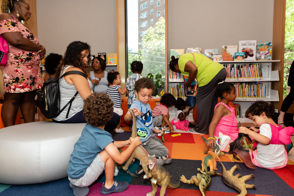 Children get ready to watch a puppet show in the kids section of the new Van Cortlandt Library location on Cannon Place.