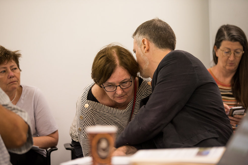 James Rausse, director of planning and development for the Bronx borough president's office, whispers to Community Board 8 chair Rosemary Ginty during a hearing last week on proposed changes to Special Natural Area District regulations in the Bronx.