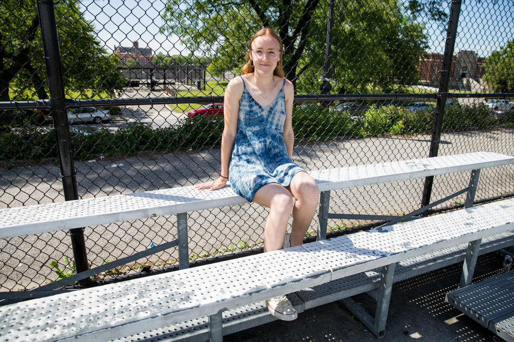 Ava Grill Dubois, a key contributor on both the basketball and softball teams at American Studies, takes one last long look at Harris Field, her former softball home.