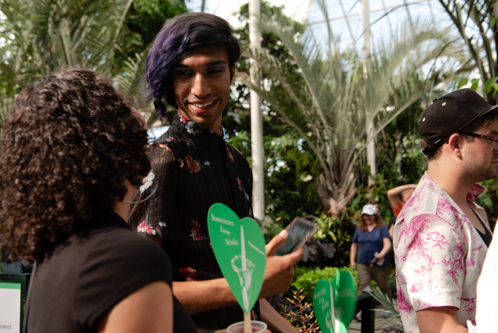 Zakary Rios lines up to get a closer look at the corpse flower during a recent visit to the New York Botanical Garden. Rios was able to stomach the stench, so much so he could recognize its odd beauty.