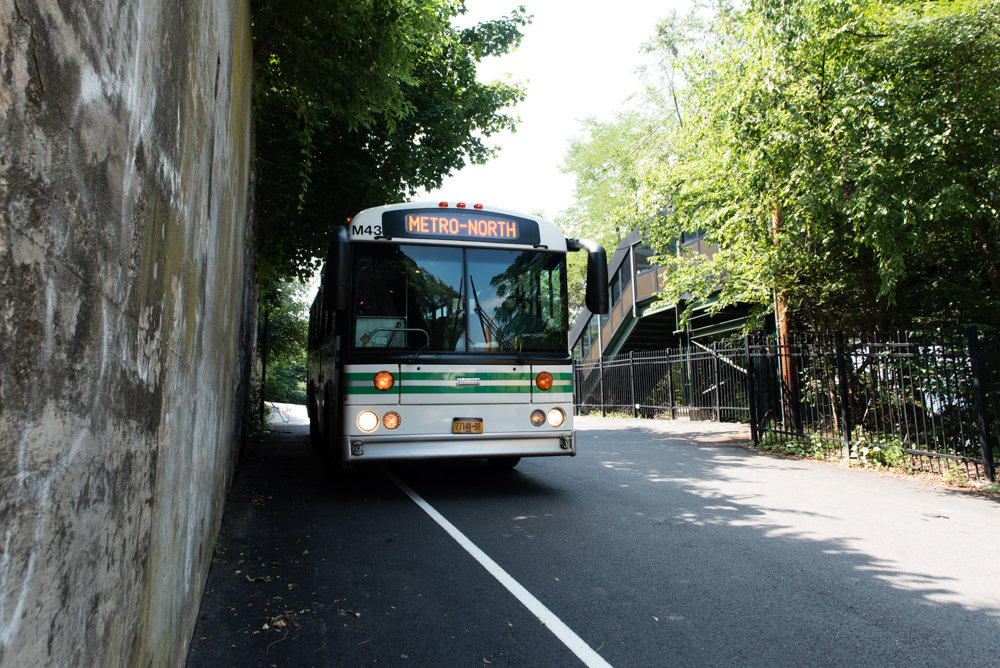 A Hudson Rail Link bus idles before reaching the pickup point at the Riverdale Metro-North station. The Rail Link has provided transportation back into the business district for commuters who frequent the Riverdale and Spuyten Duyvil Metro-North stations, both located at the bottom of steep hills.
