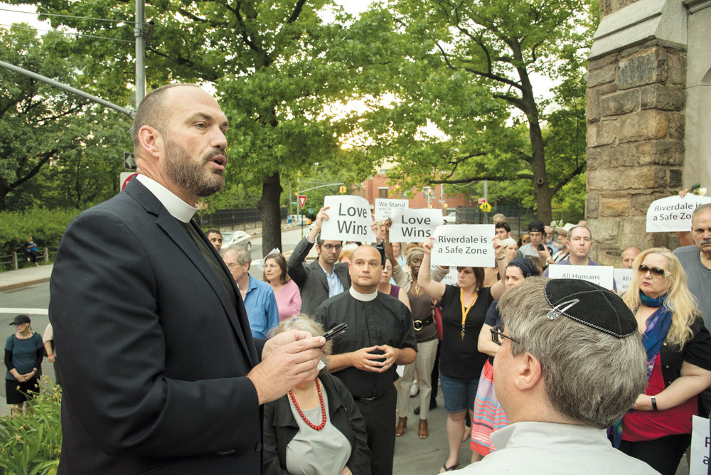 Christ Church of Riverdale Rev. Andrew Butler speaks at a vigil by the Riverdale Monument for the 49 victims of the Pulse nightclub shooting in Orlando, Florida, in 2016.