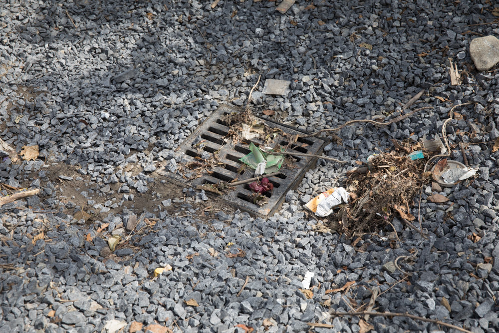 Gravel surrounds a drain on Old Albany Post Road, a derelict state-owned stretch of land that is often prone to flooding.