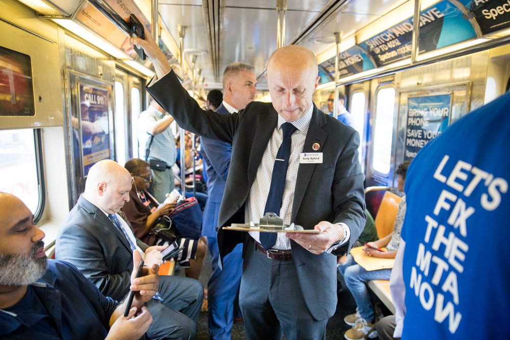 New York City Transit Authority president Andy Byford looks over a commuter survey during the third annual Riders Respond Transit Tour, a whirlwind two-day tour of the city's beleaguered transit system.