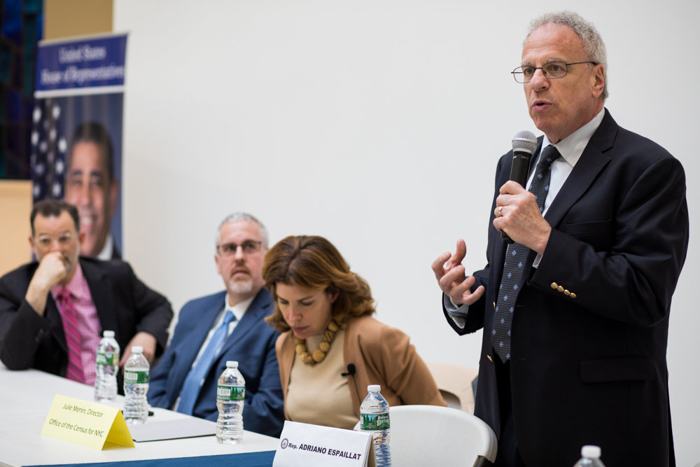 Former P.S. 24 assistant principal Manny Verdi accuses Assemblyman Jeffrey Dinowitz — shown here at a town hall in May — of libel and pressuring school officials to fire him in an ongoing lawsuit.