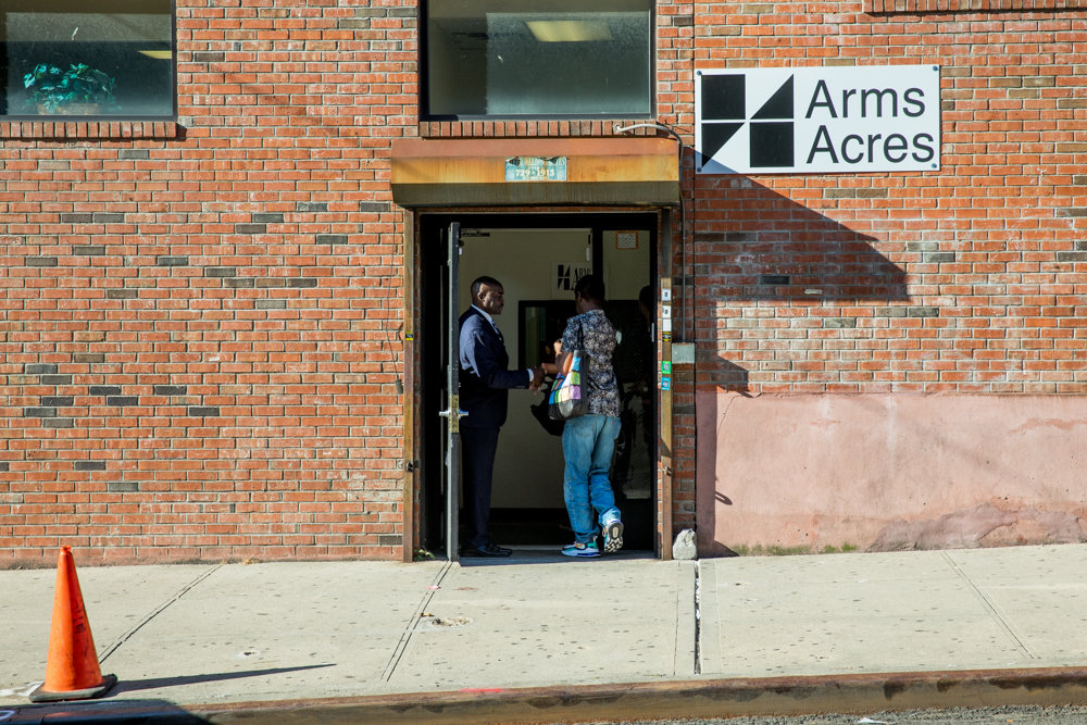 John Saunders, left, clinical director of Arms Acres on Jerome Avenue, welcomes a visitor to the outpatient treatment facility.