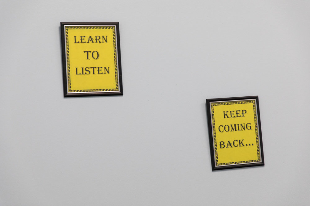 Signs in a group therapy room at Arms Acres on Jerome Avenue urge patients to 'learn to listen' and to 'keep coming back.'