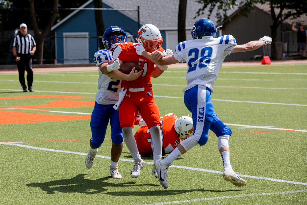 Fieldston junior quarterback Jake Horowitz fights for yardage against two Dalton defenders before a finger injury sidelined him for the second half in the Eagles' 28-19 loss.
