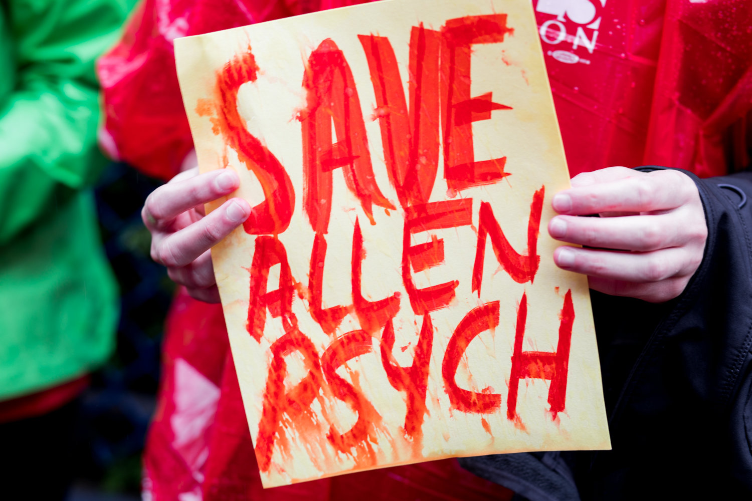 A protester holds a sign that reads 'Save Allen psych' at a rally last year against NewYork-Presbyterian's plan to decertify 30 beds in Allen Hospital's psychiatric unit. Advocates are still fighting to save the unit.