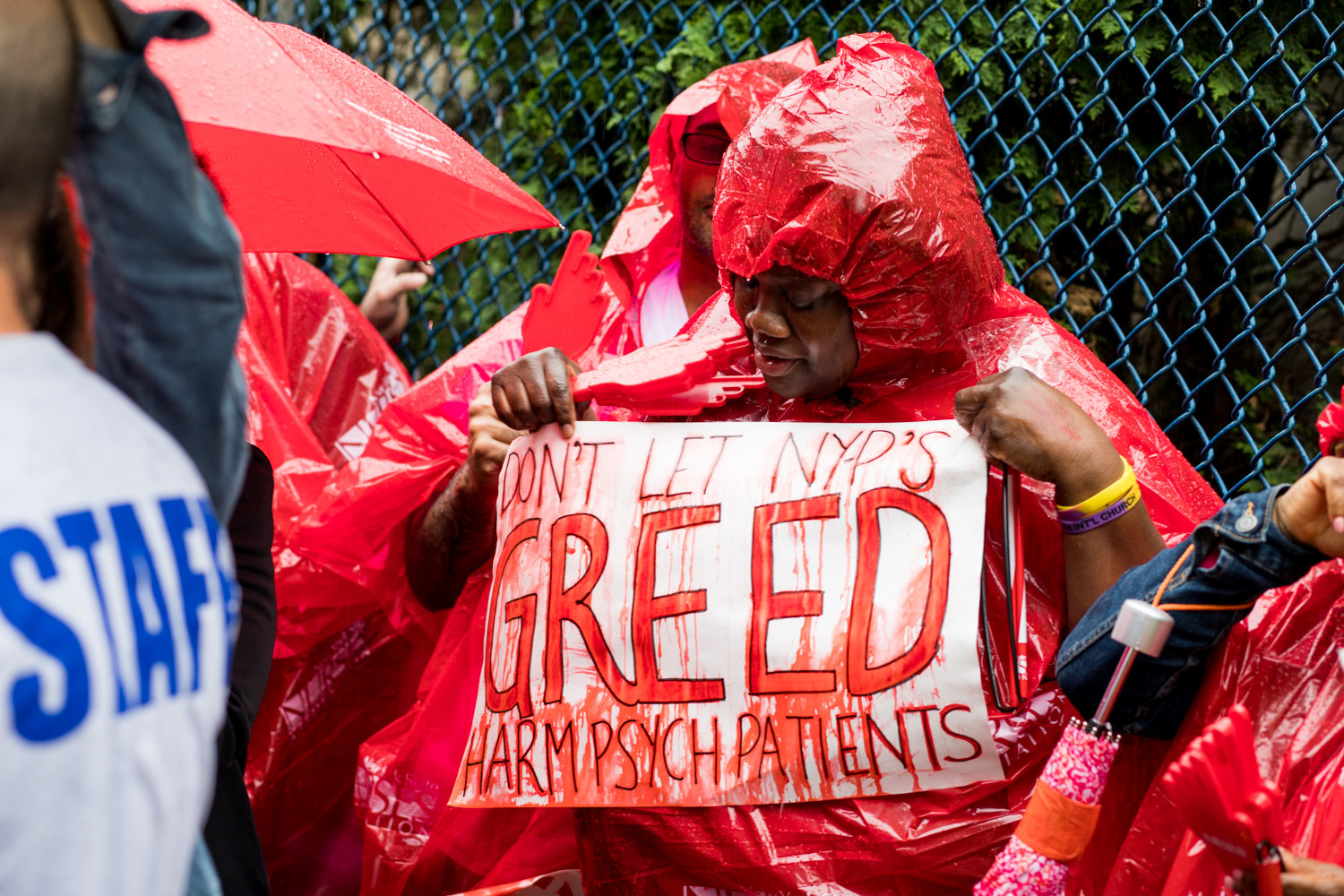 A protester holds a sign that reads 'Don't let NYP's greed harm psych patients' at a rally last year against NewYork-Presbyterian's plan to decertify 30 beds in the psychiatric at the Allen Hospital. Advocates are still fighting to save the unit.