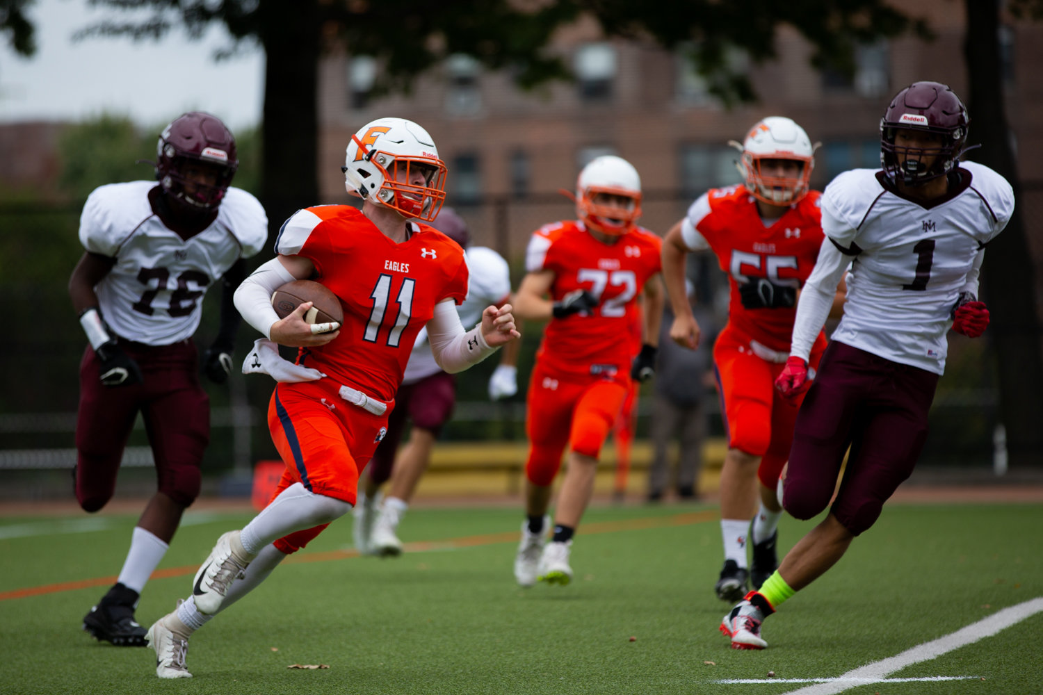 Fieldston's versatile junior Jake Horowitz cuts through Horace Mann's defense en route to one of his four touchdowns in the Eagles' 34-22 victory last Saturday.