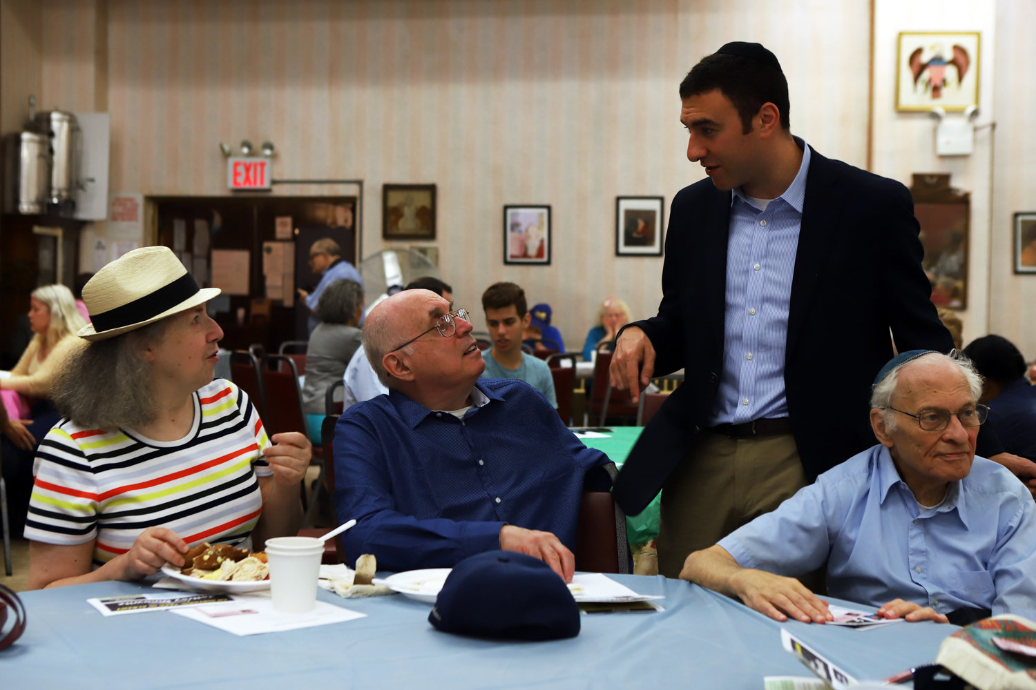 City Council candidate Eric Dinowitz speaks with community members at a brunch at the Van Cortlandt Jewish Center before state Sen. Alessandra Biaggi and his father, Assemblyman Jeffrey Dinowitz, speak to the crowd.