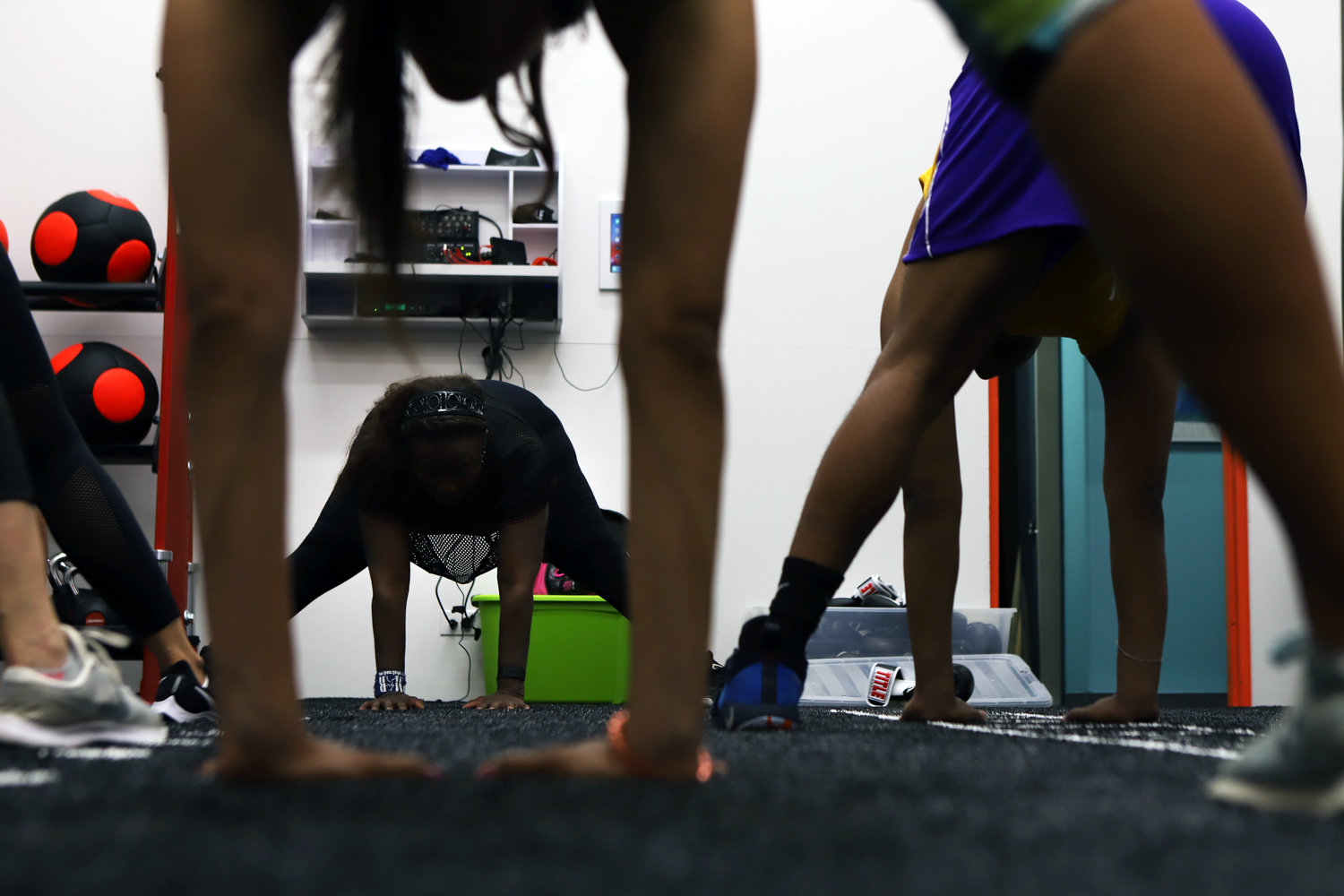 Students in a kickboxing class at The Riverdale Y's Quest Training Studio cool down with stretching. The studio was previously home to The Y's racquetball court.