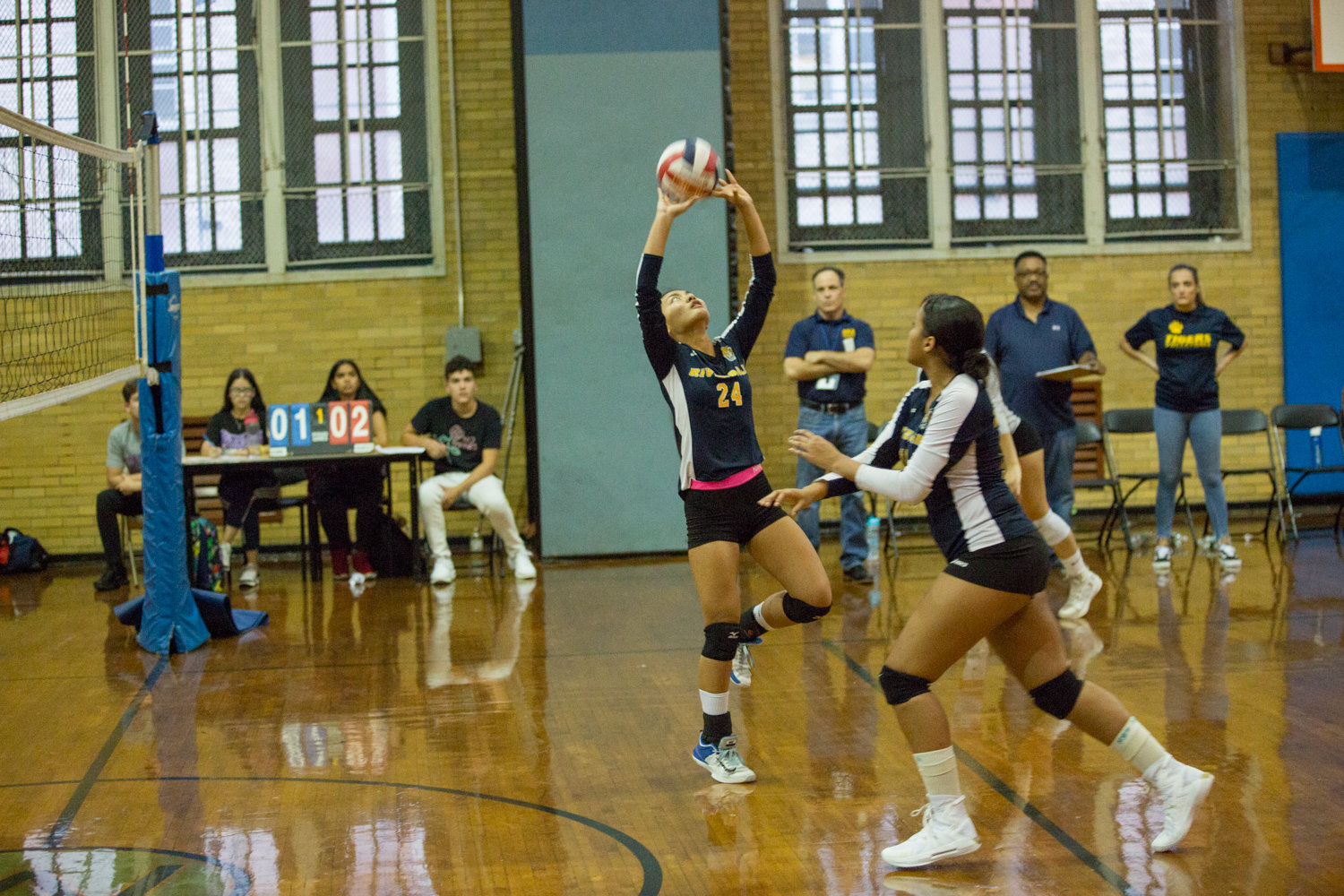Riverdale/Kingsbridge Academy's Patricia Casino sets up her teammates for one of her 14 assists in the Lady Tigers' straight-set win over South Bronx last week.