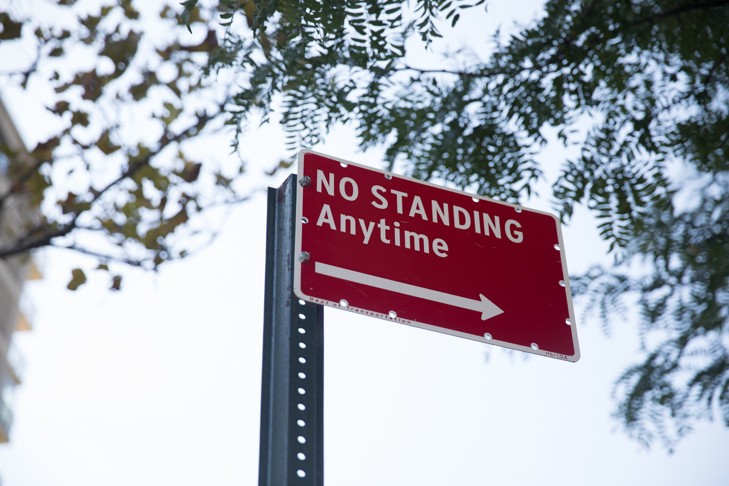 A 'no standing anytime' sign overlooks a stretch of Hudson Manor Terrace where cars can no longer park thanks to new crosswalks.