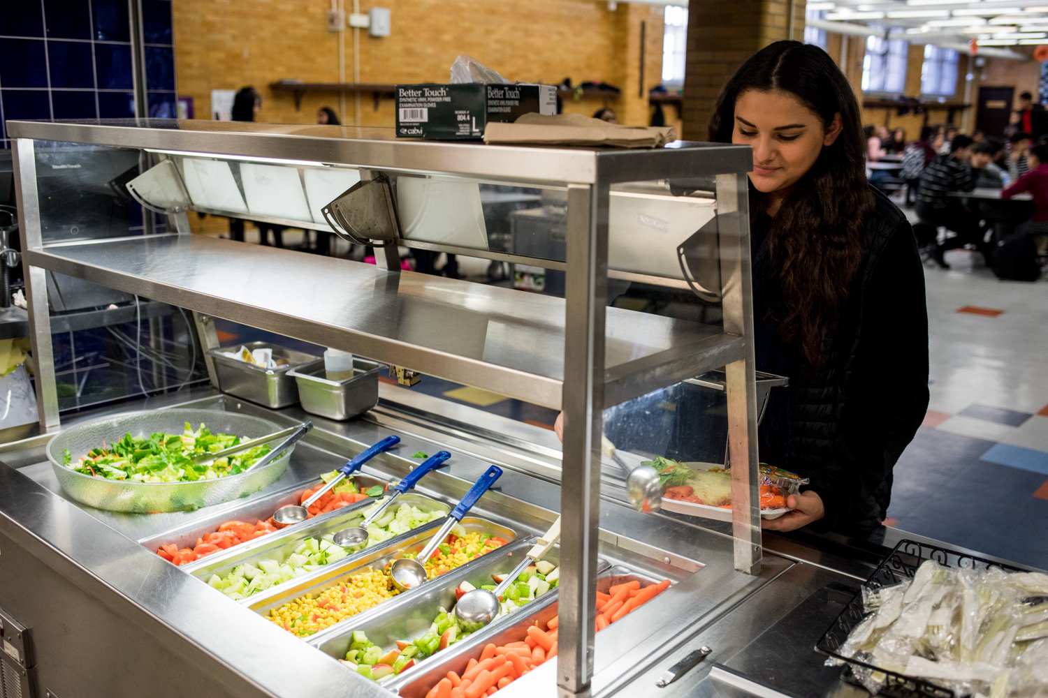 P.S./M.S. 95 Sheila Mencher student Yasmeen Masoud fills her plate with vegetables in the cafeteria in January. Councilman Fernando Cabrera has championed healthy foods with a resolution the city council passed that, if the school district followed its recommendation, would ban processed meats, including bacon and hot dogs, from public schools.