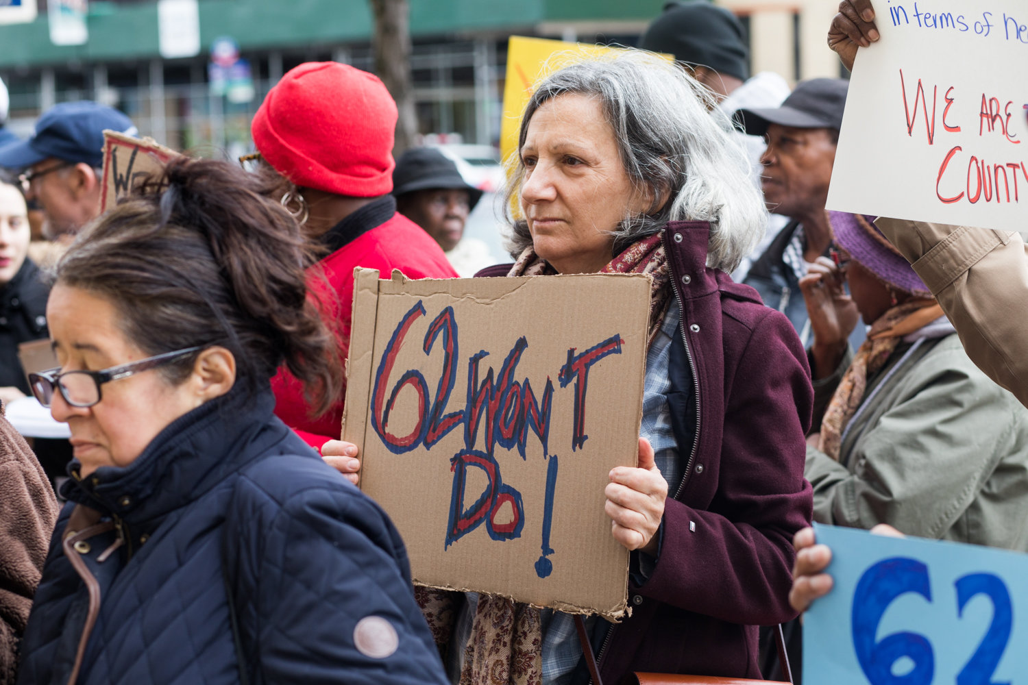 A woman holds a sign that reads '62 won't do' at a rally last year calling for improvements in health care in the Bronx, which ranked last out of the 62 counties in New York in the County Health Rankings and Roadmaps Report.