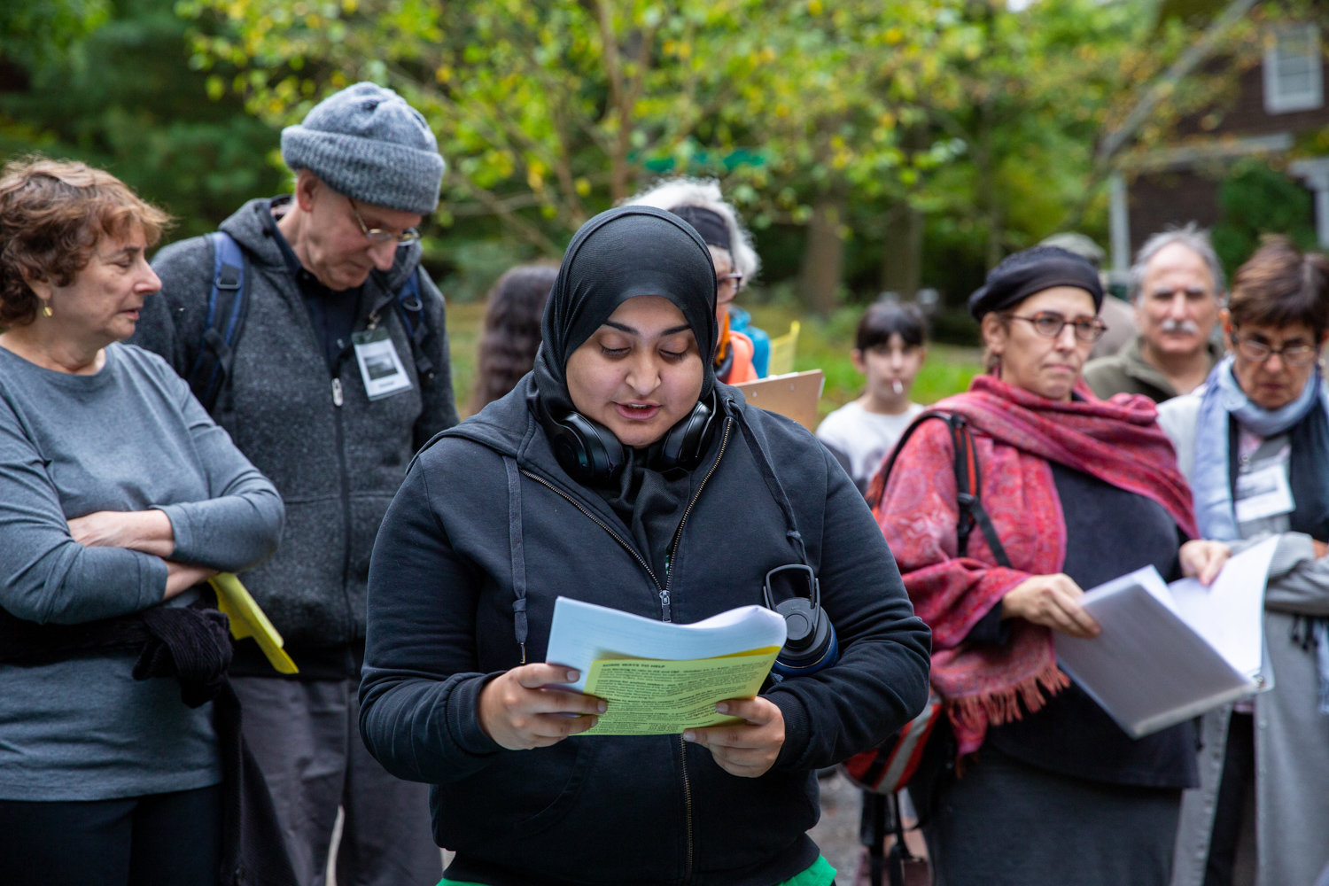 Manhattan College senior Rabea Ali spoke about an asylum-seeking family fleeing violence in Guatemala during a Tashlich ceremony near Delafield Pond that was held, in part, to call attention to the plight of asylum seekers.