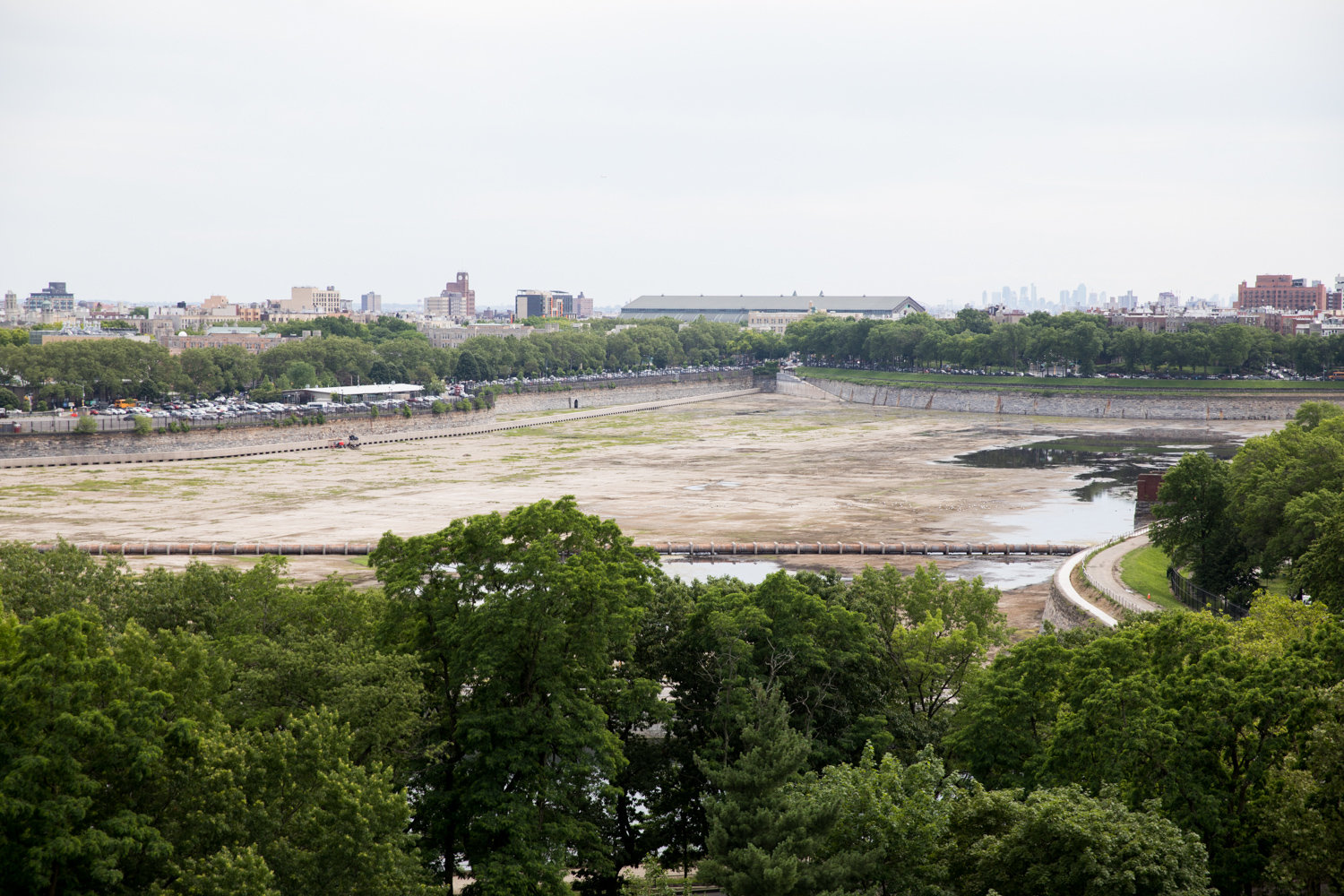The Jerome Park Reservoir's south basin has seen better days. Currently empty for repair work, the south basin will be full once that work is complete around 2025, according to the city's environmental protection department. A full south basin means the north basin will be permanently empty as a failsafe, earning the ire of its neighbors.