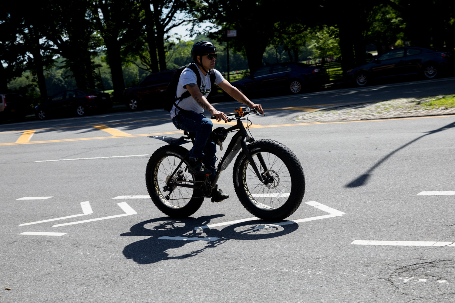 A cyclist rides south on Broadway in a bike lane. Alternative transportation advocate Eben Weiss is glad bicycle lanes have come to Broadway, but laments the fact they don't connect to a wider network of bus lanes, making it difficult for people who want to use them.