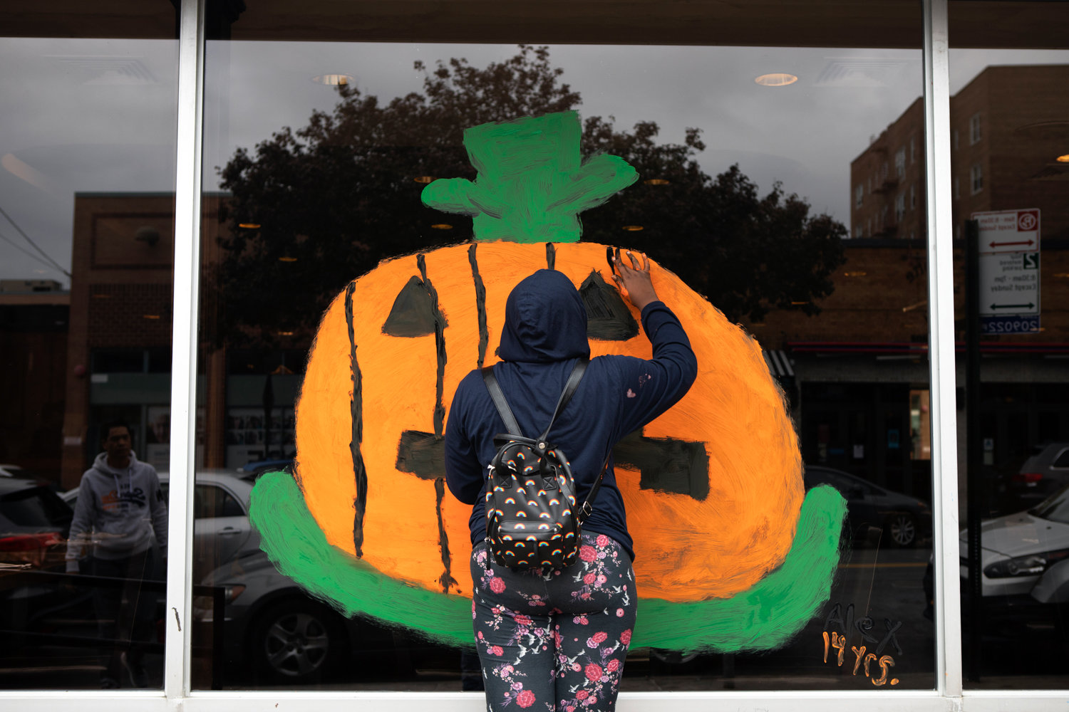 Business display windows along Riverdale and Johnson avenues got a fresh coat of paint, like this jack-o-lantern, during the Kiwanis Club's annual Halloween window painting contest.