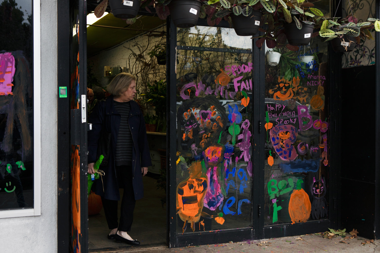 John's Botany Bay Florist was among the businesses along Riverdale Avenue to participate in the Kiwanis Club's annual Halloween window painting contest where children were allowed to be the artists.