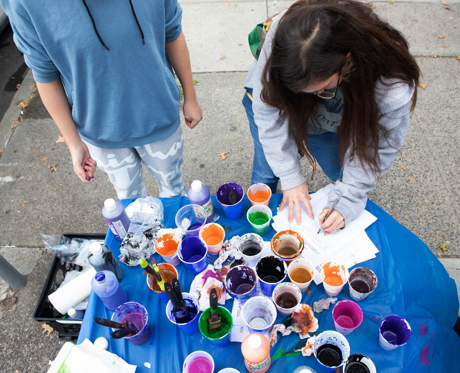 Used paint cups sit on a table during the Kiwanis Club's annual Halloween window painting contest last weekend along Johnson Avenue.