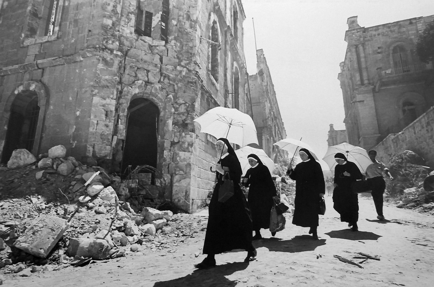 Christians pass through the New City in Jerusalem in a 1967 photograph by Leonard Freed. He was a staff photographer at Israel Magazine in the 1960s, later joining the legendary agency Magnum Photos.
