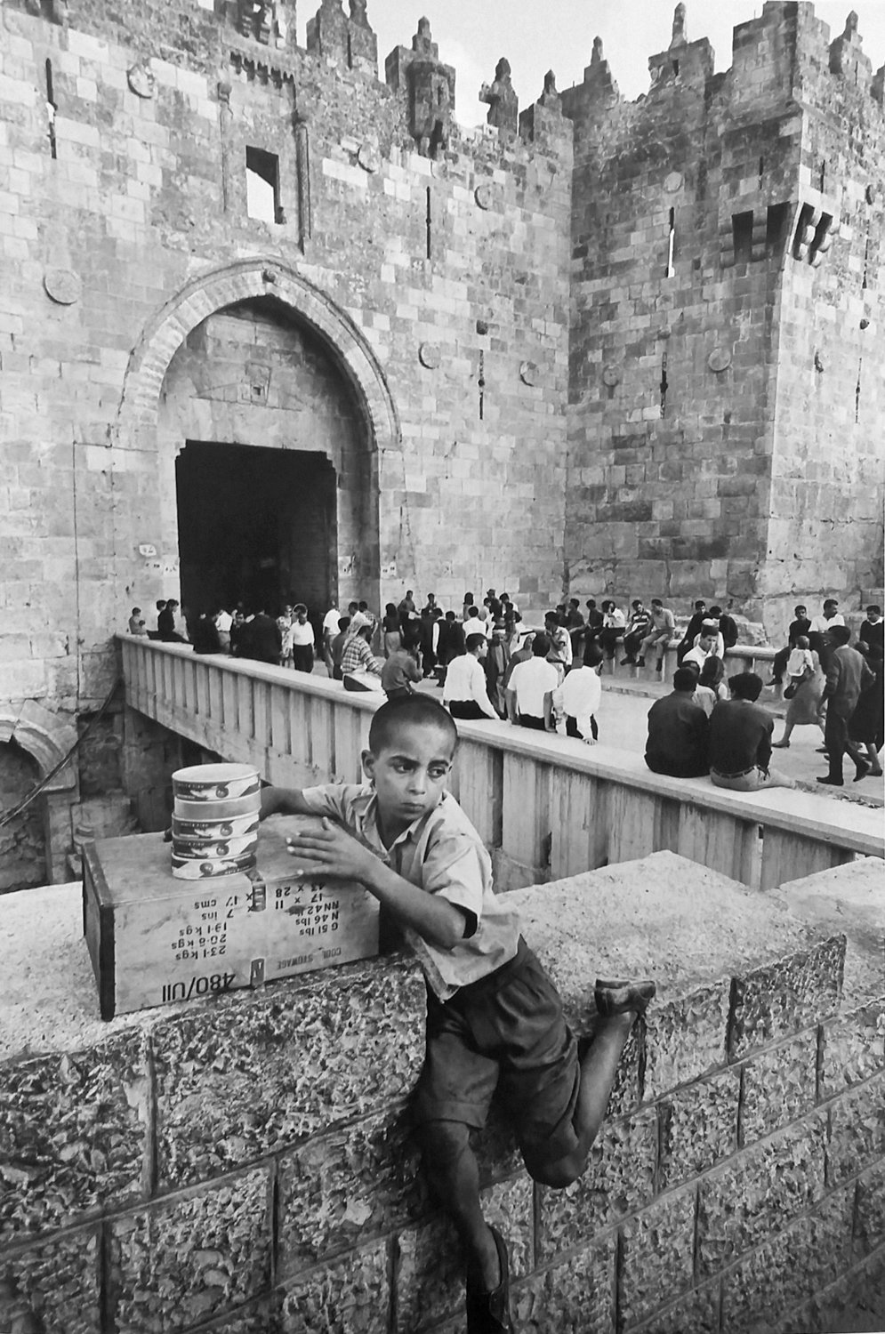 An Arab fish seller is stationed near the Damascus Gate in Jerusalem in a 1967 photograph by Leonard Freed.