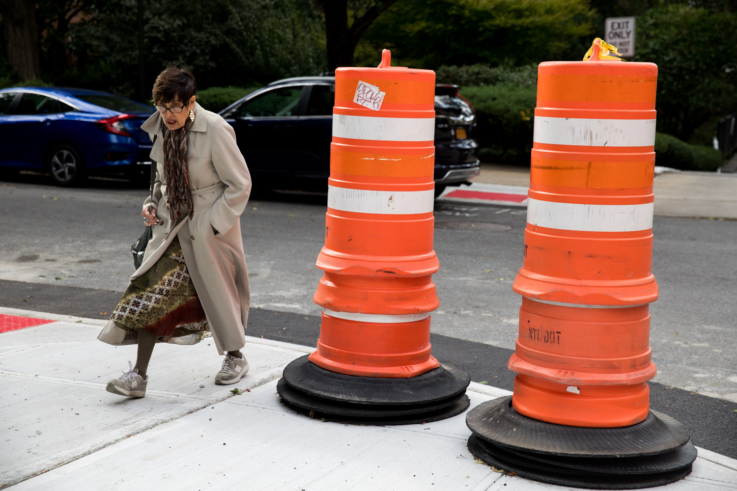 A pedestrian walks onto Kappock Street after crossing Palisade Avenue. The transportation department is extending curbs at intersections like this to narrow crosswalks.